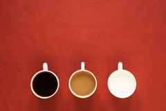 Three cups with milk and coffee Stock Photo