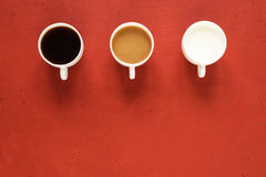 Three cups with milk and coffee Stock Photography
