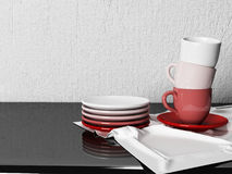 Three cups and the plates on the table Stock Image