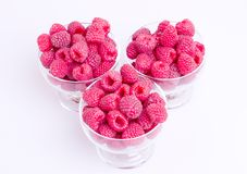 Three cups raspberries Royalty Free Stock Images