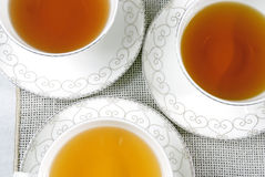 Three cups of tea. On the table Stock Image