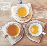 Three cups with tea on the stand royalty free stock photography
