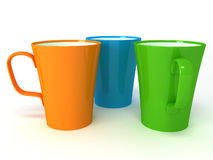 Three cups on white background Stock Photos