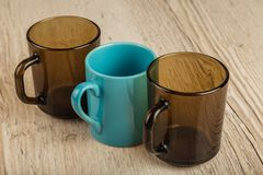 Three cups on a wooden background in different positions. Three cups on a wooden background in different positions stock images