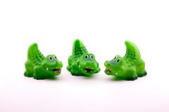 Three Curious Toy Crocodiles or Alligators Royalty Free Stock Images