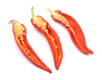 Three cut hot chili peppers isolated on white Stock Photography