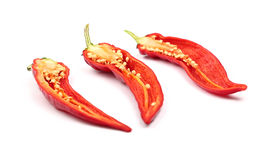 Three cut hot chili peppers isolated on white Stock Image