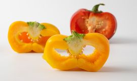 Three cut peppers. two yellow and one red. royalty free stock photography