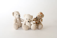 Three cute bears together. On the white background Stock Image