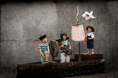 Three cute boys on pirate ship as sailors. On a summer day royalty free stock photos
