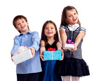 Three cute children gives gifts Stock Photo