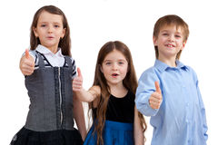 Three cute children shows good sign Royalty Free Stock Images