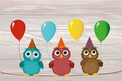 Three cute colored owls sitting on a rope and holding balloons. Royalty Free Stock Photography