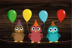 Three cute colored owls sitting on a rope and holding balloons. Stock Images