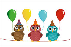 Three cute colored owls sitting on a rope and holding balloons. Royalty Free Stock Photo