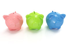 Three cute colorful piggy banks Stock Image