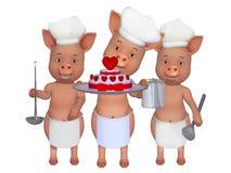 Three cute cooks Stock Photos