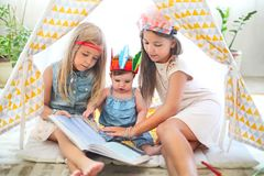 Three cute girl playing together royalty free stock photography