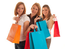Three cute girls with shopping bags Stock Photography