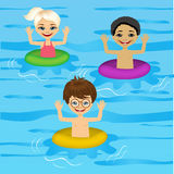 Three cute little kids swimming Stock Photos