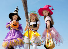 Three Cute Little Witches Standing with Broom Stock Photos