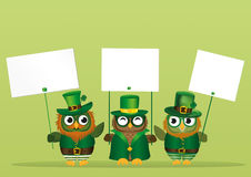 Three cute owls with a beard and mustache in a national costume Stock Image