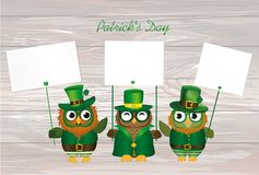 Three cute owls with a beard and mustache in a national costume Stock Images