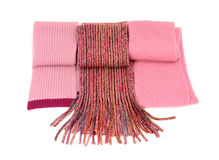 Three cute pink winter scarves nicely arranged. Stock Photos