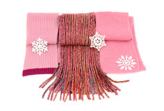 Three cute pink winter scarves with snowflakes. Stock Image