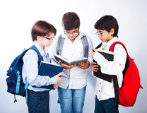 Three cute schoolboys read books Stock Image