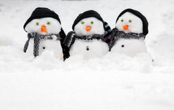 Three cute snowmen with copy space Royalty Free Stock Images