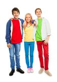 Three cute teens stand with hands on shoulders Royalty Free Stock Photos