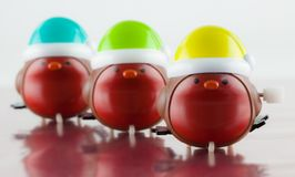 Three cute windup plastic robin toys. Closeup of three cute windup plastic robin toys with colorful hats Royalty Free Stock Images