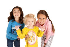 Three cute young girls leaning towards the camera Royalty Free Stock Photography