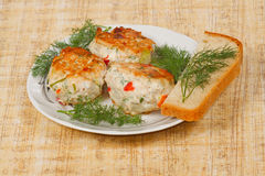 The three cutlets with fresh greens. The three appetite cutlets with fresh greens and bread Stock Photo