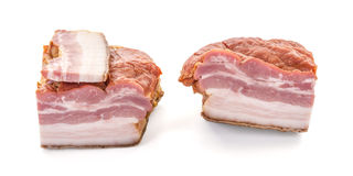 Three cuts of bacon Closeup. Three Big Cuts of Smoked Bacon over White Background, shallow focus, horizontal shot Royalty Free Stock Image