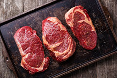Three cuts of Raw fresh meat Steaks Stock Photo