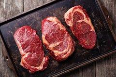 Three cuts of Raw fresh meat Steaks Stock Photo