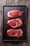 Three cuts of Raw fresh meat Steaks Royalty Free Stock Images