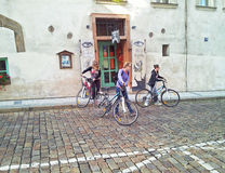 Three cyclist girls leaving the Maly Buddha cafe. Prague, Czech Republic - September 27, 2014: Three young girls had lunch in Maly Buddha Cafe. Now they are Stock Images
