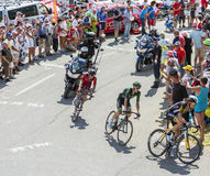 Three Cyclists on Col du Glandon - Tour de France 2015 Stock Image