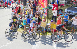 Three Cyclists on Col du Glandon - Tour de France 2015 Royalty Free Stock Images