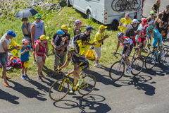 Three Cyclists on Col du Grand Colombier - Tour de France 2016 Royalty Free Stock Photo