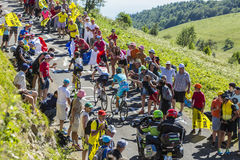Three Cyclists on Col du Grand Colombier - Tour de France 2016 Stock Photos