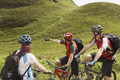 Three Cyclists In Countryside Stock Images