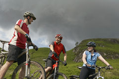 Three Cyclists In Countryside Royalty Free Stock Photos