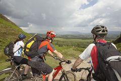 Three Cyclists On Countryside Track Royalty Free Stock Image