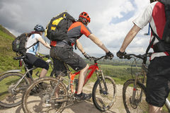Three Cyclists On Countryside Track Royalty Free Stock Images