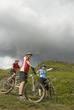 Three Cyclists Hillside Stock Photography