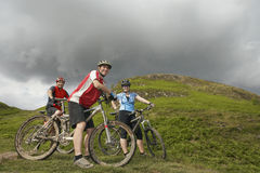 Three Cyclists Hillside Royalty Free Stock Photos